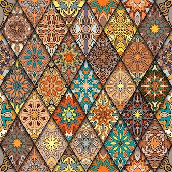 Modèle sans couture vintage coloré avec éléments floraux et mandala. fond dessiné à la main.