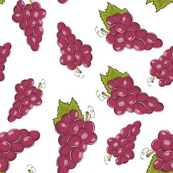 Modèle sans couture vintage avec des raisins rouges.
