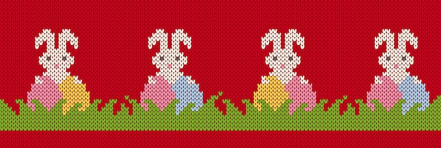 Modèle de seamles en tricot avec des lapins de pâques et des œufs dans l'herbe. joyeuses pâques fond rouge avec des lapins