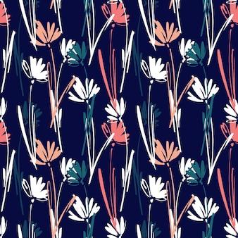 Modèle seamless vector avec main dessinant des fleurs, des herbes et des plantes sauvages.