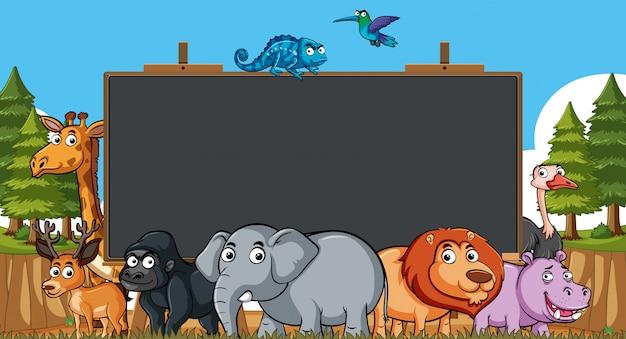 Modèle de tableau avec des animaux sauvages sur le terrain