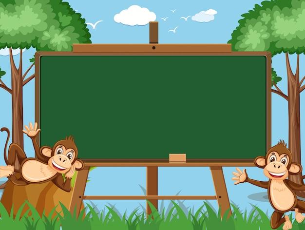 Modèle de tableau noir avec deux singes heureux