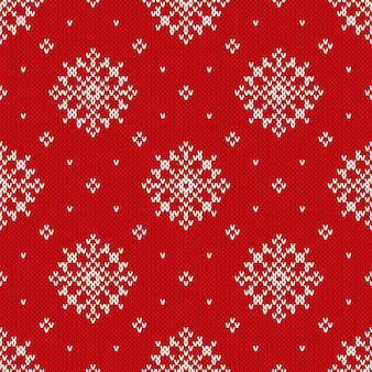 Modèle tricoté de vacances d'hiver avec des flocons de neige. fond de tricot sans couture