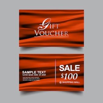 Modèle de vecteur de fond orange de luxe de chèque-cadeau