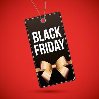 Modèle de vendredi noir avec noeud d'or sur fond rouge