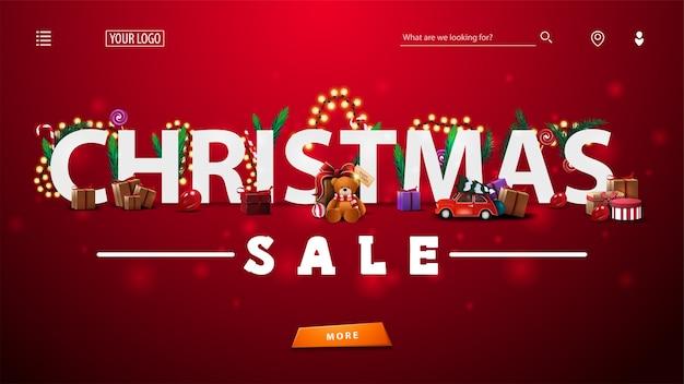 Modèle web ou page de destination avec vente de noël décorée de cadeaux, de branches d'arbres, de bonbons et de guirlandes, grande offre et bouton