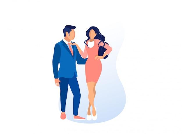 Modèles homme et femme dans des vêtements à la mode posant