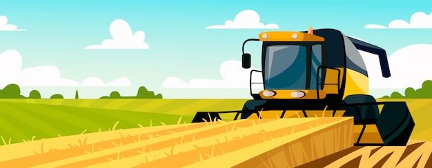 La moissonneuse jaune recueille la récolte dans le champ.