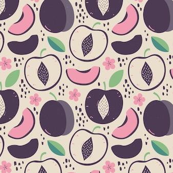 Moitiés de fruits de prune et de fleurs avec motif de feuilles