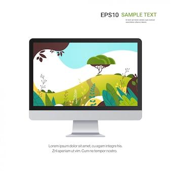 Moniteur avec beau fond d'écran paysage sur écran isolé sur des dispositifs de maquette réalistes mur blanc