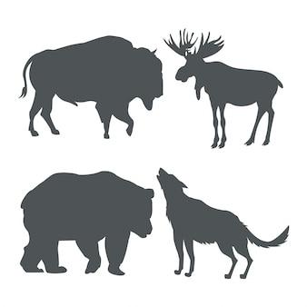 Monochrome set silhouette animaux de la faune des montagnes enneigées