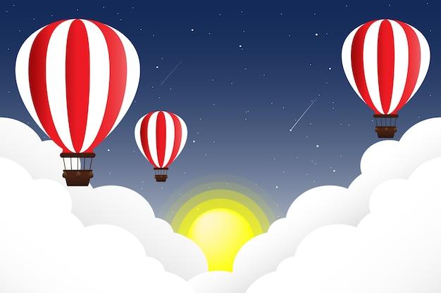 Montgolfière flottant dans le ciel avec nuages et soleil, ciel du soir.