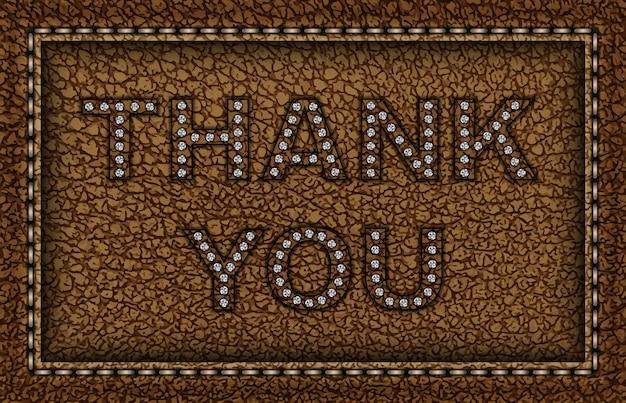 Monture en cuir marron avec inscription merci avec des paillettes argentées.
