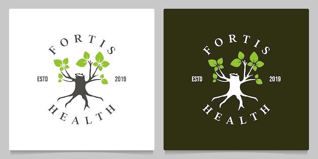 Morceaux d'arbres qui poussent feuilles conception de logo vinage