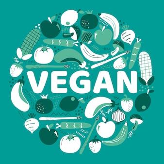 Le mot vegan entouré de fruits et légumes.