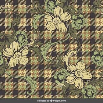 Motif à carreaux avec des fleurs ornementales