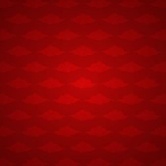 Motif chinois de nuages peints sur fond rouge.