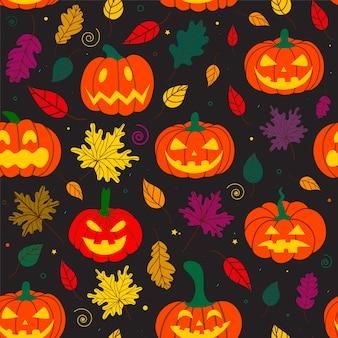 Motif citrouille d'halloween avec des feuilles d'automne
