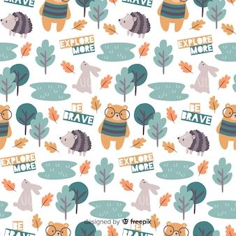 Motif coloré d'animaux et de mots de la forêt doodle