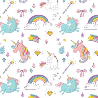 Le motif dessiné main magique avec licorne, arc en ciel