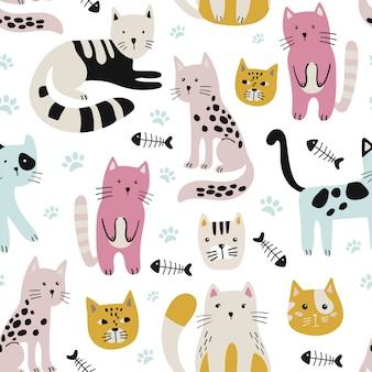 Motif enfantin sans couture avec des chats mignons.