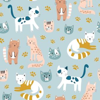Motif enfantin sans couture avec des chats mignons