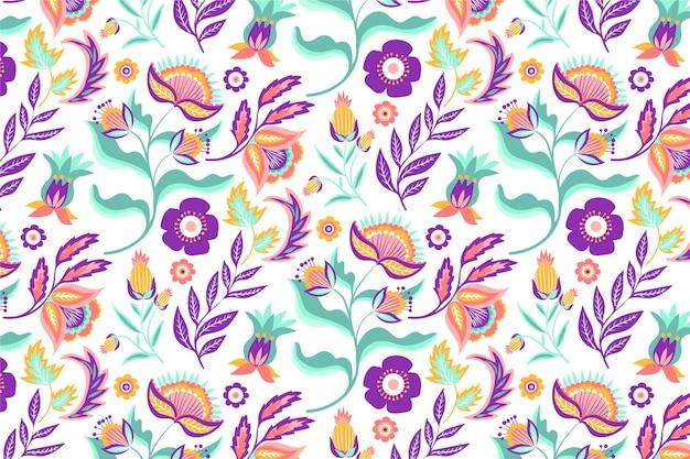Motif de feuilles et de fleurs tropicales colorées