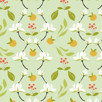 Motif de fleurs blanches et de fruits orange