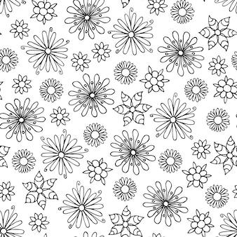Motif de fleurs sans couture dessiné de main en noir et blanc.