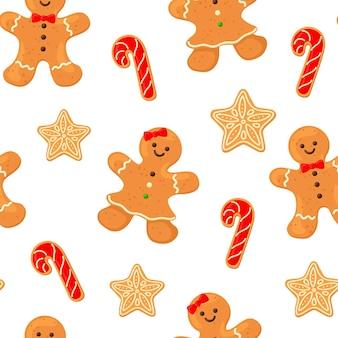 Motif de flocons de neige de biscuits de pain d'épice de petit homme avec le bâton de caramel de glaçage