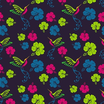 Motif floral avec colibris et fleurs d'hibiscus