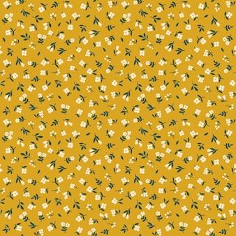 Motif floral fleurs fond jaune moutarde impression avec petites fleurs blanches imprimé ditsy