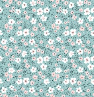 Motif floral fleurs mignonnes fond bleu clair design avec petites fleurs blanches imprimé ditsy