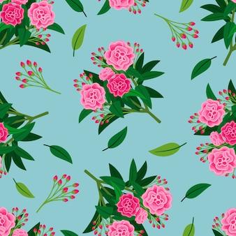 Motif floral avec des fleurs de pivoine rose et des feuilles vertes sur bleu