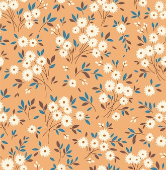 Motif floral. jolies fleurs, fond chameau. impression avec de petites fleurs blanches. impression ditsy