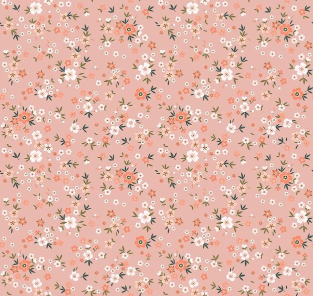Motif floral jolies fleurs fond corail impression petites fleurs imprimé petites fleurs