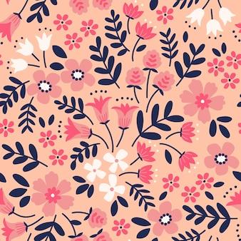 Motif floral jolies fleurs fond corail impression de petites fleurs roses imprimé ditsy