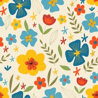 Motif floral sans couture motif mignon avec des fleurs multicolores plates sur fond beige