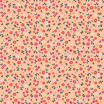 Motif floral sans couture pour la conception petites fleurs colorées fond corail impression vintage mignonne
