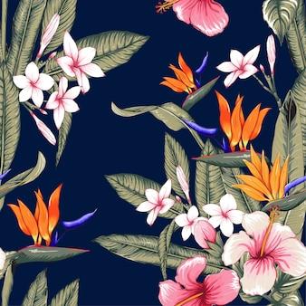 Motif floral sans soudure hibiscus, frangipanier fleurs fond bleu foncé.