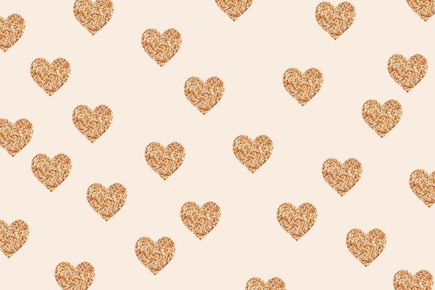Motif en forme de coeur de particules de couleur dorée scintillante
