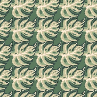 Motif géométrique sans couture avec impression de feuilles de monstera décoratives dessinées à la main.