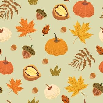 Motif harmonieux décoré d'éléments floraux comme le noyer, le gland, les feuilles d'érable, la citrouille, les champignons et la fougère. illustrations de récolte d'automne pouvant être utilisées comme impression textile, tissu, papier d'emballage.