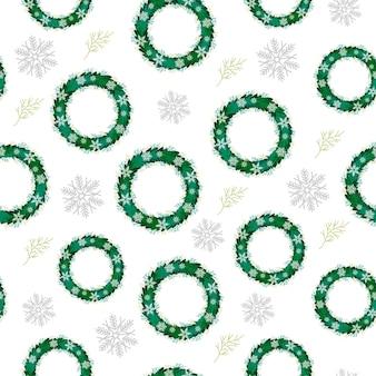 Motif de noël de couronnes et de flocons de neige nouvel an et couronne de noël sur fond blanc