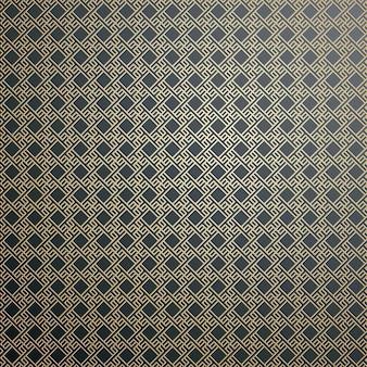 Motif or islamique avec des formes carrées géométriques qui se chevauchent formant un ornement abstrait.