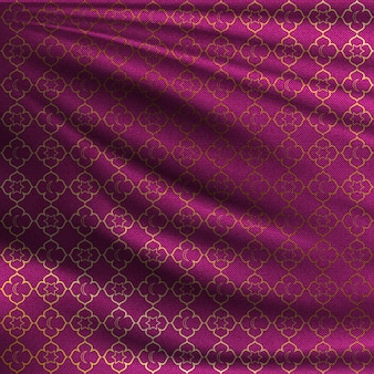 Motif oriental doré sur tissu de soie ondulé