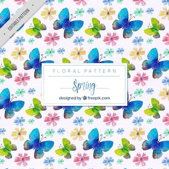 Motif de papillons bleus et fleurs d'aquarelle