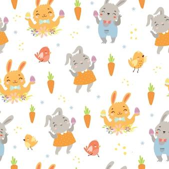 Motif de pâques avec des lièvres et des carottes