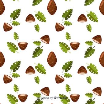 Motif plat de noix de coco et feuilles