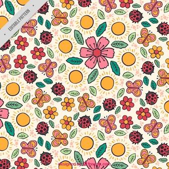 Motif de printemps avec des fleurs et des insectes